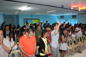 Praise and Worship Him! The church members start the anniversary by lifting their voices up and bowing their heads low.