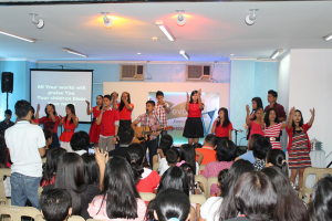 Give Praise to the Lord! Don in red, these young people render a special number that extols the goodness of God.