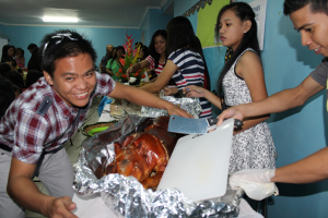 Attack! Bro. Jobert can't wait to munch the crispy skin of lechon.