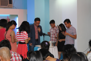 Take My body. Ptr. Jessie Yu, together with Ptr. Rachel Yu and the leadership team,  leads the communion.
